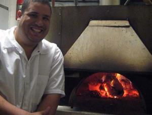 Alejandro Briceno and his wood-burning oven