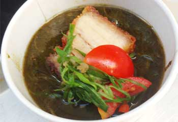 Mark Noguchi's luau stew topped with lecon and marinated tomatoes